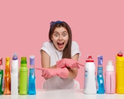 indoor-shot-happy-european-lady-with-overjoyed-expression-keeps-mouth-opened-crosses-hand-indicates-two-sides-detergents
